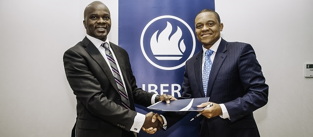 Turnkey CEO, Mr. K. Makatiani with Liberty Holding's Director, General Insurance Xolani Xolani Nxanga